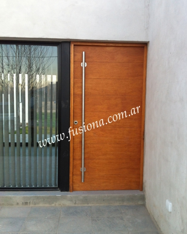 Mas modelos de puertas de entrada modernas de madera for Modelos de puertas de ingreso